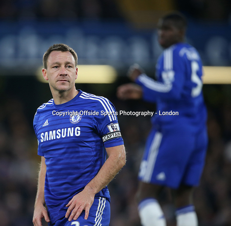 10 January 2015 Premier League Football - Chelsea v Newcastle United ;  Chelsea captain John Terry gives an angry look to a refereeing assistant.<br /> Photo: Mark Leech