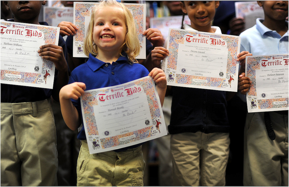 Hannah Brooks and other Bass students receive a Terrific Kid award the school gives out every month during a special ceremony.