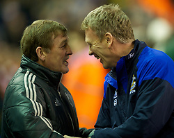 LIVERPOOL, ENGLAND - Tuesday, March 13, 2012: Liverpool's manager Kenny Dalglish and Everton's manager David Moyes, on his 10th anniversary as the club's manager, before the Premiership match at Anfield. (Pic by David Rawcliffe/Propaganda)