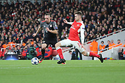 Arsenal midfielder Aaron Ramsey (8) tackling Bayern Munich attacker Frank Ribery (7) during the Champions League round of 16, game 2 match between Arsenal and Bayern Munich at the Emirates Stadium, London, England on 7 March 2017. Photo by Matthew Redman.