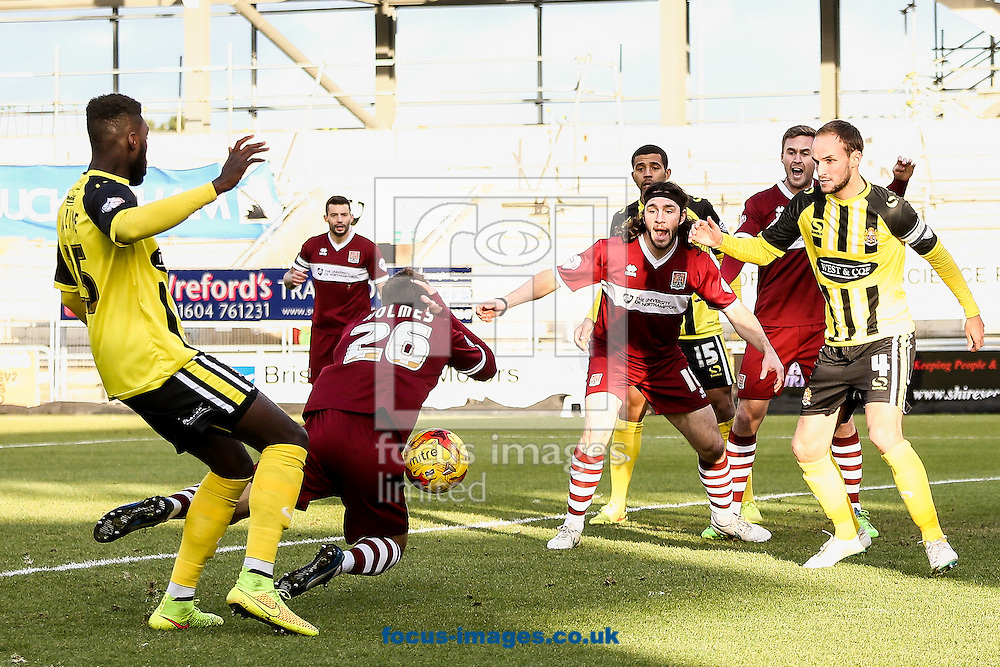 Ricky Holmes of Northampton Town (2nd left) goes down in the penalty area during the Sky Bet League 2 match at Sixfields Stadium, Northampton<br /> Picture by Andy Kearns/Focus Images Ltd 0781 864 4264<br /> 17/01/2015
