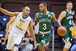 Nov 28, 2016; Morgantown, WV, USA; Manhattan Jaspers guard Zavier Turner (3) dribbles while guarded by West Virginia Mountaineers guard Jevon Carter (2) during the first half at WVU Coliseum. Mandatory Credit: Ben Queen-USA TODAY Sports