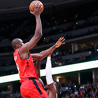 01 November 2017: Toronto Raptors forward Serge Ibaka (9) goes for the layup against Denver Nuggets forward Paul Millsap (4) during the Denver Nuggets 129-111 victory over the Toronto Raptors, at the Pepsi Center, Denver, Colorado, USA.