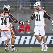 John Ranagan #31 of the Rochester Rattlers and Miles Thompson #74 of the Rochester Rattlers celebrate an early goal during the game at Harvard Stadium on August 9, 2014 in Boston, Massachusetts. (Photo by Elan Kawesch)