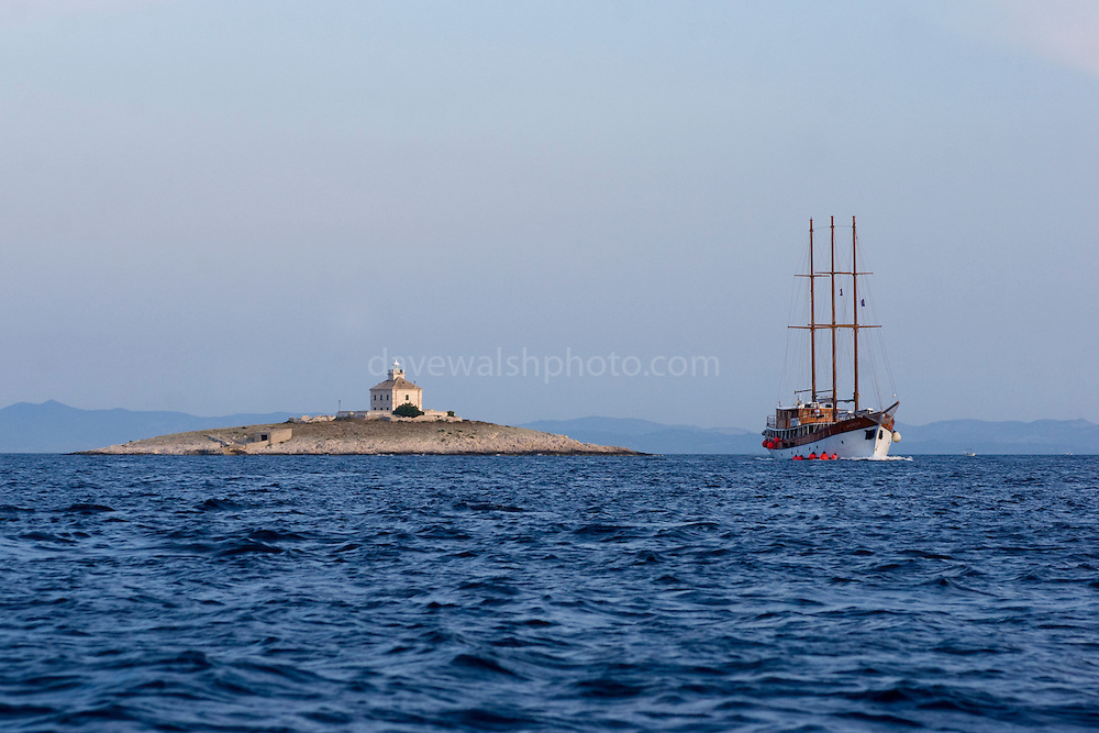 Yacht passing the island of Pokonji Dol, near Hvar, Croatia
