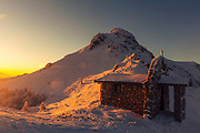 Echo hut in Central Balkan at sunrise in winter time