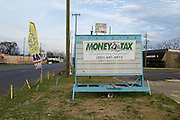BIRMINGHAM, AL – MARCH 21, 2014: Signage for a Money Tax branch in Birmingham's predominantly poor neighborhood of Ensley. During tax season, many locally owned tax preparation services rake in large profits by promising high tax returns to their customers. CREDIT: Bob Miller for The New York Times