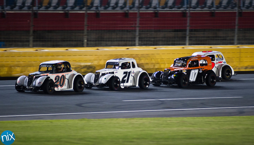 Tyler Green (20), from China Grove leads Daniel Hemric (21), from Kannapolis during heat races for the Big Money 100 at Charlotte Motor Speedway Monday afternoon (photo by James Nix)