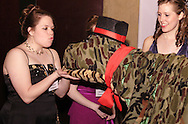 WSU freshman Madeleine Casto (left) puckers up as if to kiss Fredrick the Dinosaur (aka sophomore Alex Goodman) at the 2008 Arts Gala at Wright State University, Saturday, April 5, 2008.