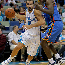 Oct 10, 2009; New Orleans, LA, USA;  New Orleans Hornets forward Peja Stojakovic (16) drives past Oklahoma City Thunder center Nenad Krstic (12) during the second quarter at the New Orleans Arena. Mandatory Credit: Derick E. Hingle-US PRESSWIRE