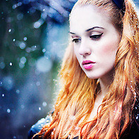 portrait of a pale redhead during winter time, looking down