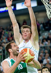 Dusan Djordjevic of Krka vs Vladimer Boisa of Olimpija during second semi-final match of Basketball NLB League at Final four tournament between KK Union Olimpija and Krka (SLO), on April 19, 2011 in Arena Stozice, Ljubljana, Slovenia. (Photo By Vid Ponikvar / Sportida.com)