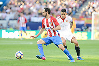 "Atletico de Madrid's Juanfran Torres and Sevilla's Victor ""Vitolo"" Machin during La Liga match between Atletico de Madrid and Sevilla CF at Vicente Calderon Stadium in Madrid, Spain. March 19, 2017. (ALTERPHOTOS/BorjaB.Hojas)"