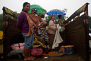 11/4/2010 Kemalang, Indonesia:group of  people have to go from their refugee camp for get another camp that dry. rain make their shelter become wet and very cold.