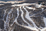 Aerial view of Cascade Mountain, rural Columbia County, Wisconsin in the winter on an overcast day.