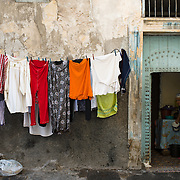 A woman looks out of her doorway in Casablanca, Morocco on 7 September 2013.