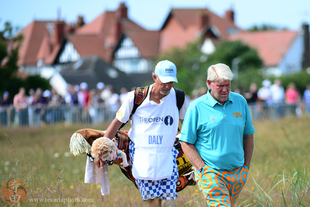July 21, 2012; St. Annes, ENGLAND; John Daly (right) and caddy Peter van der Riet (left) walk on the 16th hole during the third round of the 2012 British Open Championship at Royal Lytham & St. Annes Golf Club.