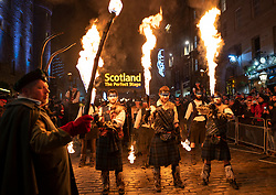 Edinburgh, Scotland, UK. 30th Dec 2019. Edinburgh's famous Hogmanay celebrations get under way with the Torchlight Procession along the historic Royal Mile in Edinburgh's Old Town and ending at Holyrood Park. The procession was led by the Celtic Fire Theatre company, PyroCeltica and the Harbinger Drum Crew. Iain Masterton/Alamy Live News