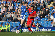 Paul McGinn fouls Nathaniel Mendez-Laing during the EFL Sky Bet League 1 match between Chesterfield and Rochdale at the b2net stadium, Chesterfield, England on 25 March 2017. Photo by Daniel Youngs.