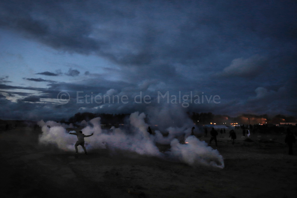 """Migrants in Calais """"Jungle"""" camp clashes with French riot police as tensions rise few days before the closure of the camp and relocations of these migrants to be implement by the French authorities. 0ctober 22, 2016."""