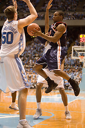 UVA's Sean Singletary (44) navigates around North Carolina defender Tyler Hansbrough (50).  The #1 ranked Tar Heels beat the Cavaliers 79-69 to improved to 15-1 overall, 2-0 ACC on January 10, 2007 at the Dean Smith Center in Chapel Hill, NC...<br />
