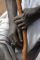 Burkina Faso, Ouagadougou, 2007. A Tuareg nomad rests just next to a busy Ouagadougou intersection.