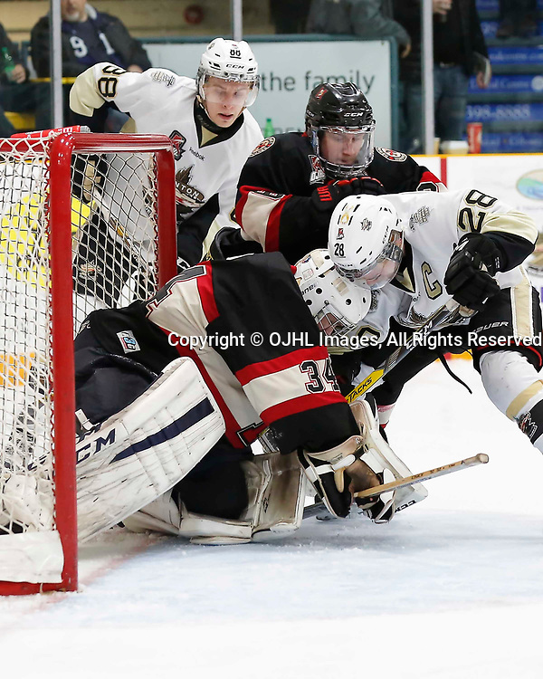 TRENTON, ON - MAR 7,  2017: Ontario Junior Hockey League, playoff game between the Trenton Golden Hawks and the Newmarket Hurricanes., Lucas Brown #28 of the Trenton Golden Hawks and Newmarket Hurricanes goalie Kirk #34 battle for the loose puck<br /> (Photo by Amy Deroche / OJHL Images)