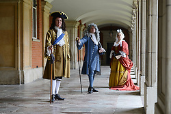 LNP HIGHLIGHTS OF THE WEEK 04/04/14 © Licensed to London News Pictures. 01/04/2014. Hampton Court Palace, England. Hampton Court will use actors to represent George I (gold), George II (blue), & Queen Caroline (red) from the Easter holidays to mix with visitors on the 300th anniversary of the Hanovarian accesion. http://www.royalcollection.org.uk/press-release/the-first-georgians-art-monarchy-1714-1760  Photo credit : Mike King/LNP