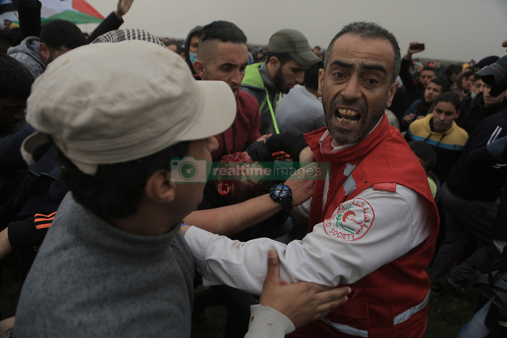 March 30, 2019 - Gaza, Palestine Territories, Palestine - Palestinian protesters carry the 17-year old body identified as Adham Omara after he was shot dead by an Israeli sniper during the clashes near the border between Israel and eastern Gaza Strip, 30 March 2019. Two Palestinian protesters were shot dead by Israeli snipers and more than 50 others wounded during the clashes eastern Gaza Strip. Palestinian protesters plan to call for the right of Palestinian refugees across the Middle East to return to homes they fled in the war surrounding the 1948 creation of Israel. (Credit Image: © Majdi Fathi/NurPhoto via ZUMA Press)