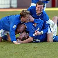 Clyde v St Johnstone...06.03.04<br />Paul Bernard (bottom of the pile) is congratulated by John Robertson, Simon Donnelly and Chris Hay<br /><br />Picture by Graeme Hart.<br />Copyright Perthshire Picture Agency<br />Tel: 01738 623350  Mobile: 07990 594431