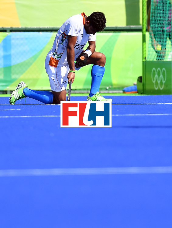 India's Uthappa Sannuvanda kneels on the pitch at the end of the men's quarterfinal field hockey Belgium vs India match of the Rio 2016 Olympics Games at the Olympic Hockey Centre in Rio de Janeiro on August 14, 2016. / AFP / MANAN VATSYAYANA        (Photo credit should read MANAN VATSYAYANA/AFP/Getty Images)