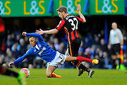 Portsmouth's Kyle Bennett is fouled by AFC Bournemouth midfielder Eunan O'Kane during the The FA Cup fourth round match between Portsmouth and Bournemouth at Fratton Park, Portsmouth, England on 30 January 2016. Photo by Graham Hunt.