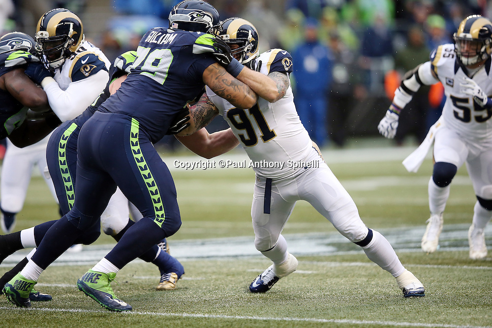 St. Louis Rams defensive end Chris Long (91) gets blocked by Seattle Seahawks tackle Garry Gilliam (79) during the 2015 NFL week 16 regular season football game against the Seattle Seahawks on Sunday, Dec. 27, 2015 in Seattle. The Rams won the game 23-17. (©Paul Anthony Spinelli)
