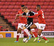 Picture by Richard Land/Focus Images Ltd +44 7713 507003<br /> 27/08/2013<br /> Steven Davis of Southampton bursts forward leading to the opening goal during the Capital One Cup match at Oakwell, Barnsley.