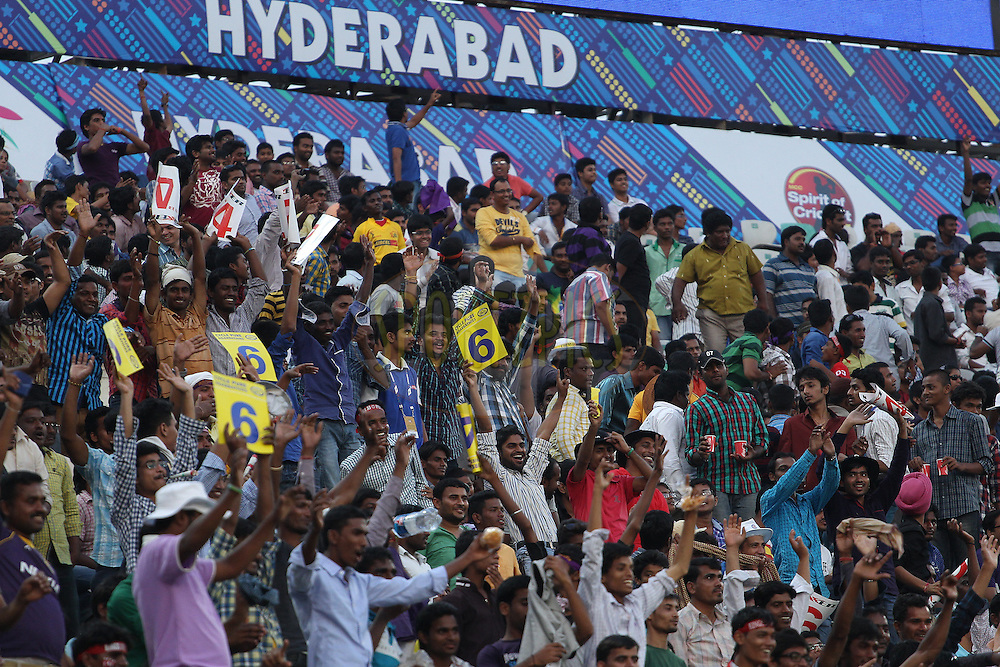 The crowd erupt as the big screen informs them that India beat Pakistan in the Hockey at the Asian Games to win gold during the first semi final match of the Oppo Champions League Twenty20 between the Kolkata Knight Riders and the Hobart Hurricanes held at the Rajiv Gandhi Cricket Stadium, Hyderabad, India on the 2nd October 2014<br /> <br /> Photo by:  Ron Gaunt / Sportzpics/ CLT20<br /> <br /> <br /> Image use is subject to the terms and conditions as laid out by the BCCI/ CLT20.  The terms and conditions can be downloaded here:<br /> <br /> http://sportzpics.photoshelter.com/gallery/CLT20-Image-Terms-and-Conditions-2014/G0000IfNJn535VPU/C0000QhhKadWcjYs