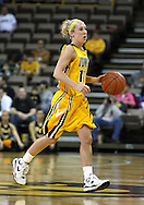 26 JANUARY 2009: Iowa guard Kristi Smith (11) brings the ball down court during the first half of an NCAA women's college basketball game Monday, Jan. 26, 2009, at Carver-Hawkeye Arena in Iowa City, Iowa. Iowa defeated Michigan 77-69.