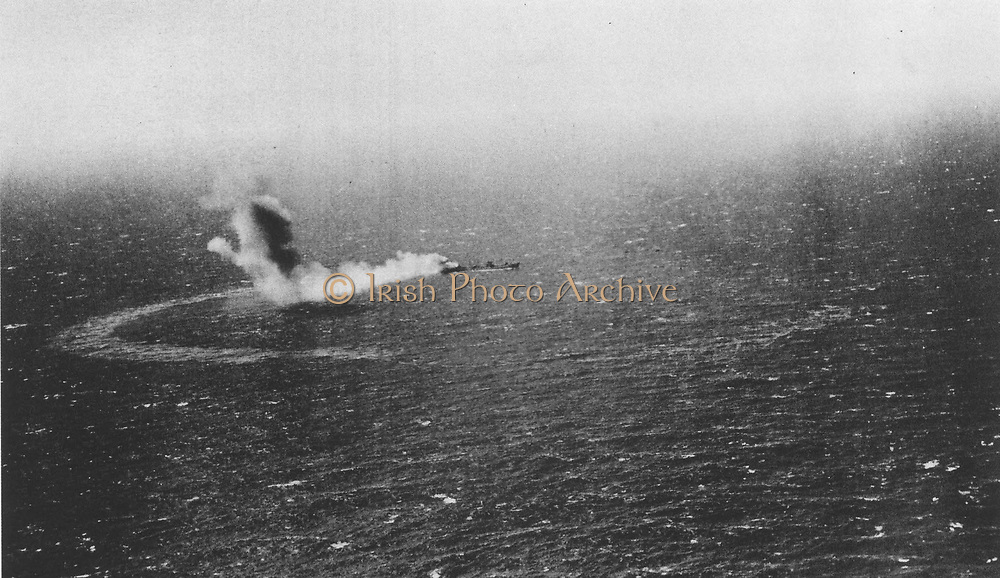 The United States Navy fleet oiler Neosho is left burning and slowly sinking after an attack by Imperial Japanese Navy dive bombers on May 7, 1942 during the Battle of the Coral Sea.