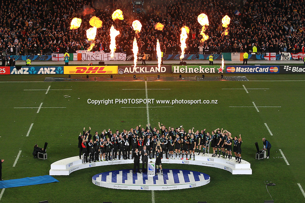 All Blacks' Captain Richie McCaw holds up the Webb Ellis Cup with the team celebrating during the All Blacks v France Final match of the 2011 IRB Rugby World Cup. Eden Park, Auckland, New Zealand. Sunday 23 October 2011. Photo: www.photosport.co.nz