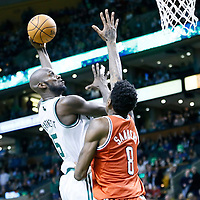 21 December 2012: Boston Celtics power forward Kevin Garnett (5) goes for the skyhook over Milwaukee Bucks center Larry Sanders (8) during the Milwaukee Bucks 99-94 overtime victory over the Boston Celtics at the TD Garden, Boston, Massachusetts, USA.