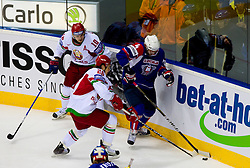 Andrei Mikhalyov of Belarus and Andrei Stas of Belarus vs Andrej Tavzelj of Slovenia during ice-hockey match between Slovenia and Belarus of Group G in Relegation Round of IIHF 2011 World Championship Slovakia, on May 8, 2011 in Orange Arena, Bratislava, Slovakia.  (Photo By Vid Ponikvar / Sportida.com)