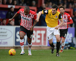 Exeter City's Clinton Morrison battles for the ball with Northampton's Evan Horwood - Photo mandatory by-line: Alex James/JMP - Mobile: 07966 386802 - 10/01/2015 - SPORT - football - Exeter - St James Park - Exeter City v Northampton - Sky Bet League Two