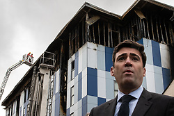 "© Licensed to London News Pictures. 16/11/2019. Bolton, UK. ANDY BURNHAM Mayor of Greater Manchester at a the site of the blaze . Firefighters work at the scene where a fire broke out overnight (15th/16th November 2019) at a block of flats known as "" The Cube "" , in Bolton Town Centre . At least two people are known to have been treated by paramedics at the scene of the six-story block , which is occupied by students of the University of Bolton . Photo credit: Joel Goodman/LNP"