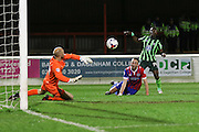Ade Azeez forward for AFC Wimbledon (14) nearly makes it 0-3,but Mark Cousins goalkeeper of Dagenham & Redbridge (30) saves  during the Sky Bet League 2 match between Dagenham and Redbridge and AFC Wimbledon at the London Borough of Barking and Dagenham Stadium, London, England on 19 April 2016. Photo by Stuart Butcher.