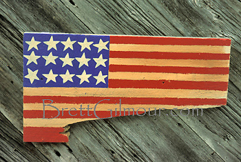 Hand crafted wooden American flag nailed to the side of a an old fishing shack between Camden and Bar Harbour, Maine, USA.