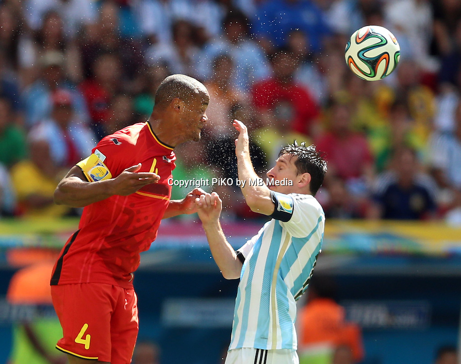 Fifa Soccer World Cup - Brazil 2014 - <br /> ARGENTINA (ARG) Vs. BELGIUM (BEL) - Quarter-finals - Estadio Nacional Brasilia -- Brazil (BRA) - 05 July 2014 <br /> Here Argentine player Lionel Messi and Belgian player Vincent KOMPANY<br /> &copy; PikoPress
