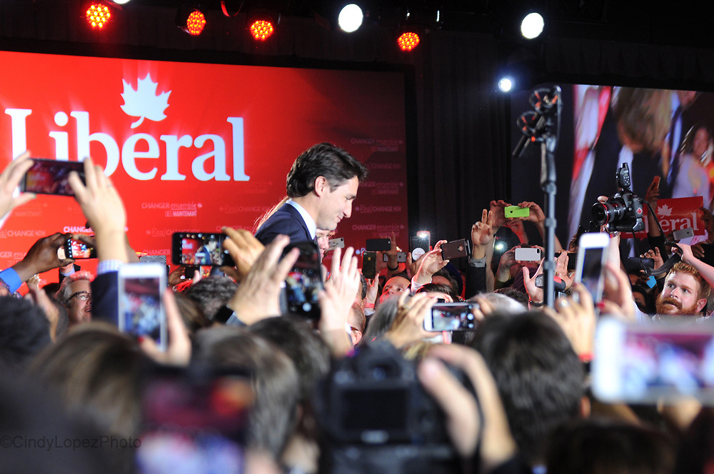 Crowds of Liberal supporters and onlookers raise their phones in capturing their personal images of newly elected Prime Minister Justin Trudeau at the Fairmont Queen Elizabeth Hotel on election night. October 2015. (Cult MTL)