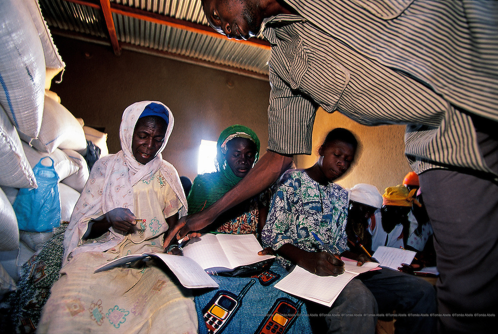 Women are the target population for the adult literacy project. Mother-child health, nutrition and family planning are also taught. Loumbila, Burkina Faso.