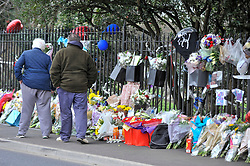 © Licensed to London News Pictures. 29/01/2018. London, UK.  People view floral tributes laid out at the site of a car crash where three teenage boys were killed in Hayes, west London, on the night of 27 January.  Jaynesh Chudasama, 28, of Hayes has been charged with three counts of causing death by dangerous driving and will appear in custody at Uxbridge Magistrates Court on Monday 29 January.  Photo credit: Stephen Chung/LNP