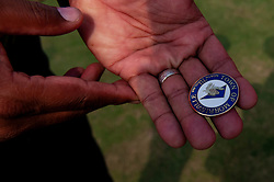 September 22, 2018 - Morrisville, North Carolina, US - Sept. 22, 2018 - Morrisville N.C., USA - An official holds the City of Morrisville coin used for the coin toss during the ICC World T20 America's ''A'' Qualifier cricket match between USA and Canada. Both teams played to a 140/8 tie with Canada winning the Super Over for the overall win. In addition to USA and Canada, the ICC World T20 America's ''A'' Qualifier also features Belize and Panama in the six-day tournament that ends Sept. 26. (Credit Image: © Timothy L. Hale/ZUMA Wire)