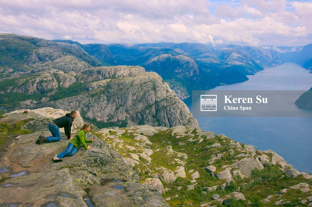 Tourists on Preikestole, Pulpit Rock, Lysefjorden below, Forsand, Rogaland, Norway